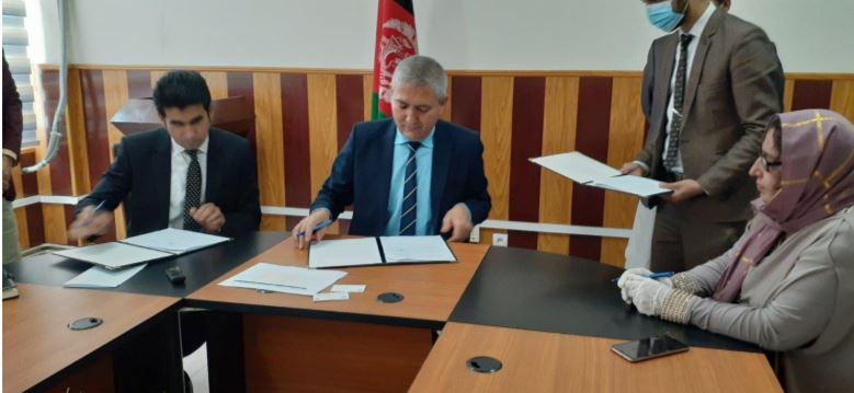 JFAO Executive Director Mahfuza Folad (right), UNISHKA Legal Advisor Mohammad Kamel Farhat (left); and Deputy Attorney General Wahid Dudin Arghoon (center); sign a long-term Memorandum of Understanding with the AGO to implement Systems Integrity Assessments, Training, and Capacity Development.